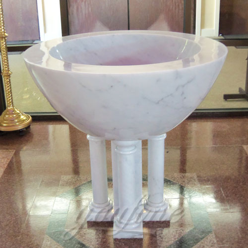 Religious Statues of White Marble Holy water Font in a Church on Stock