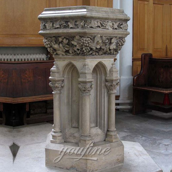 Religious statues of beautiful antique marble altar with grape and columns decor